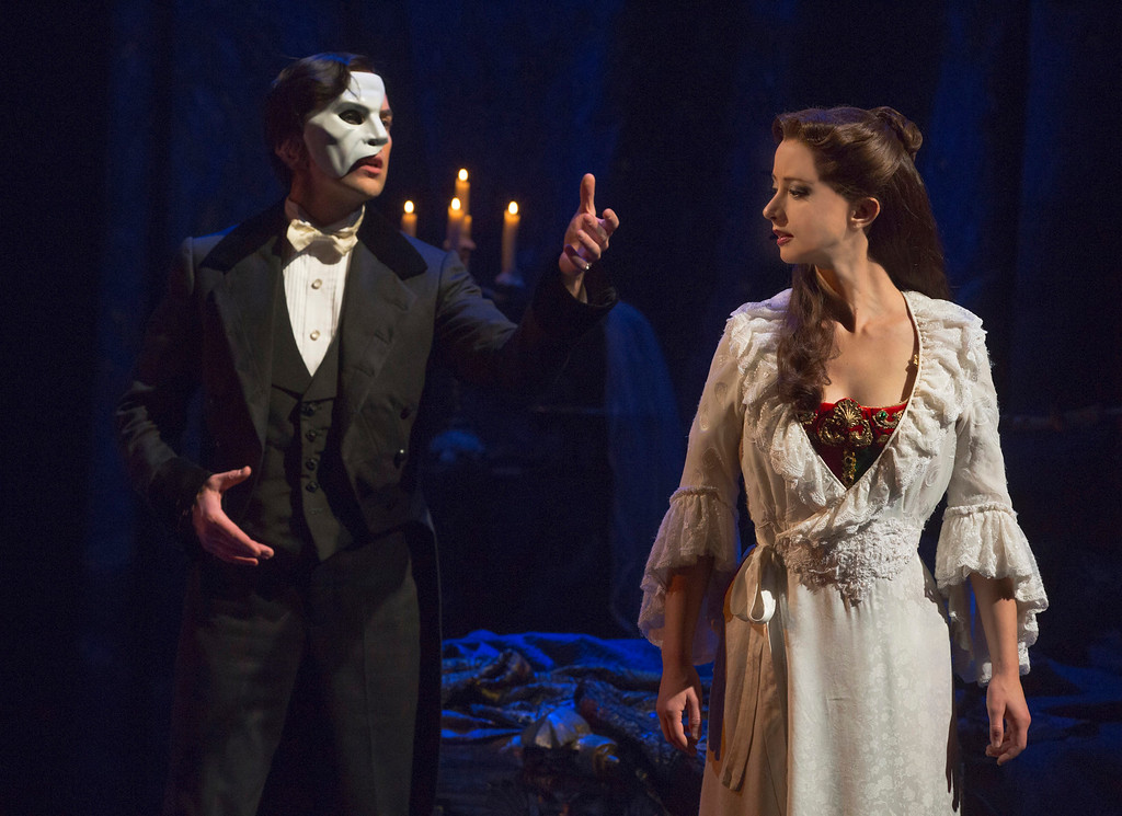 ". Chris Mann and Katie Travis share a scene during a touring production of �The Phantom of the Opera.� The show continues through July 10 at the State Theatre at Playhouse Square in Cleveland. For more information, visit <a href=""http://playhousesquare.org/\"">playhousesquare.org</a>. (photo credit: Courtesy of Playhouse Square)"