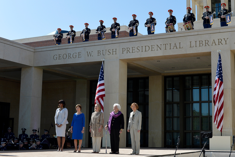 Description of . US First Lady Michelle Obama (L) and former First Ladies (L-R) Laura Bush, Hillary Clinton, Barbara Bush and Rosalynn Carter arrive on stage to attend the George W. Bush Presidential Center dedication ceremony in Dallas, Texas, on April 25, 2013.  JEWEL SAMAD/AFP/Getty Images