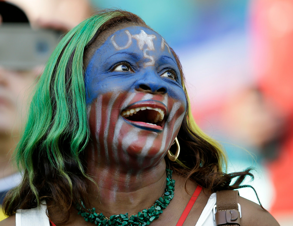 . A US supporter waits for the start of the World Cup round of 16 soccer match between Belgium and the USA at the Arena Fonte Nova in Salvador, Brazil, Tuesday, July 1, 2014. (AP Photo/Natacha Pisarenko)