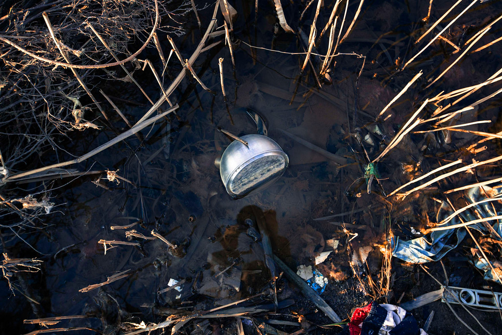 . A teapot sits with other debris among reeds after being deposited in a marshy area by the storm surge of superstorm Sandy in the Staten Island borough neighborhood of Oakwood in New York, November 28, 2012.  REUTERS/Lucas Jackson