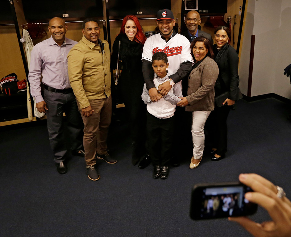 . Cleveland Indians\' Edwin Encarnacion poses with his family after a news conference, Thursday, Jan. 5, 2017, in Cleveland. One win from a World Series baseball title last season, the Indians finalized a $65 million, three-year contract with free agent slugger Encarnacion. (AP Photo/Tony Dejak)