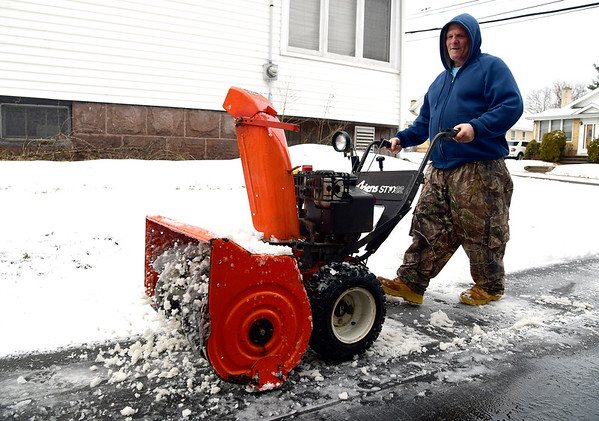 3/2/2019 Mike Orazzi | Staff Robert Sampp while clearing snow along Francis Street in New Britain Saturday.