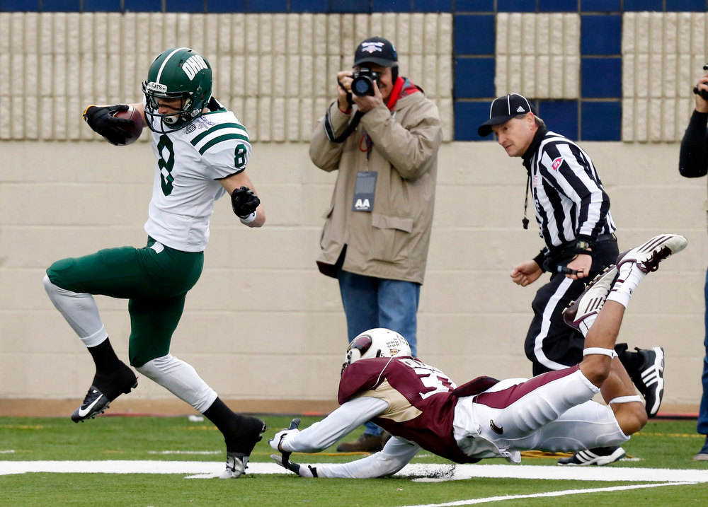 . Ohio wide receiver Chase Cochran (8) dodges a tackle by Louisiana-Monroe safety Mitch Lane (38) en route to a 68-yard touchdown reception during the first quarter of the Independence Bowl NCAA college football game in Shreveport, La., Friday, Dec. 28, 2012. (AP Photo/Rogelio V. Solis)