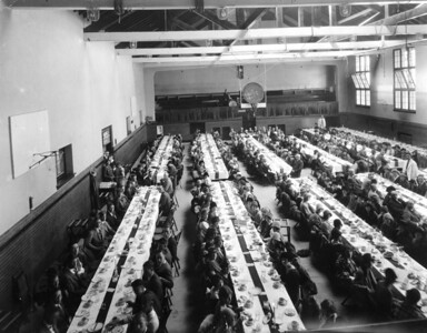 Homecoming dinner - The men's gym was used as a Dining Hall prior to the 1950s, when coed dining commenced in Taylor Hall