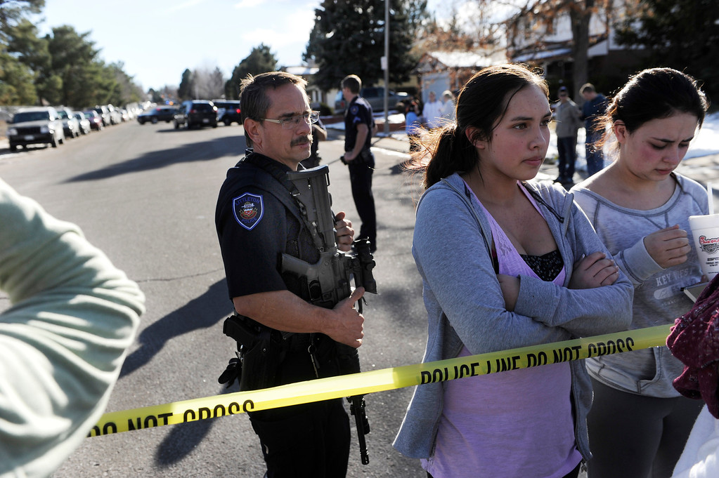 . Students were detained inside a perimeter until the situation was less chaotic. Parents waited to be reunited with their children outside Arapahoe High School Friday afternoon, December 13, 2013. A shooting inside the school sent hundreds of students rushing for safety. Photo By Karl Gehring/The Denver Post