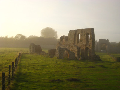 The Friary Ruins on the Dunwich cliffs in an evening sea mist