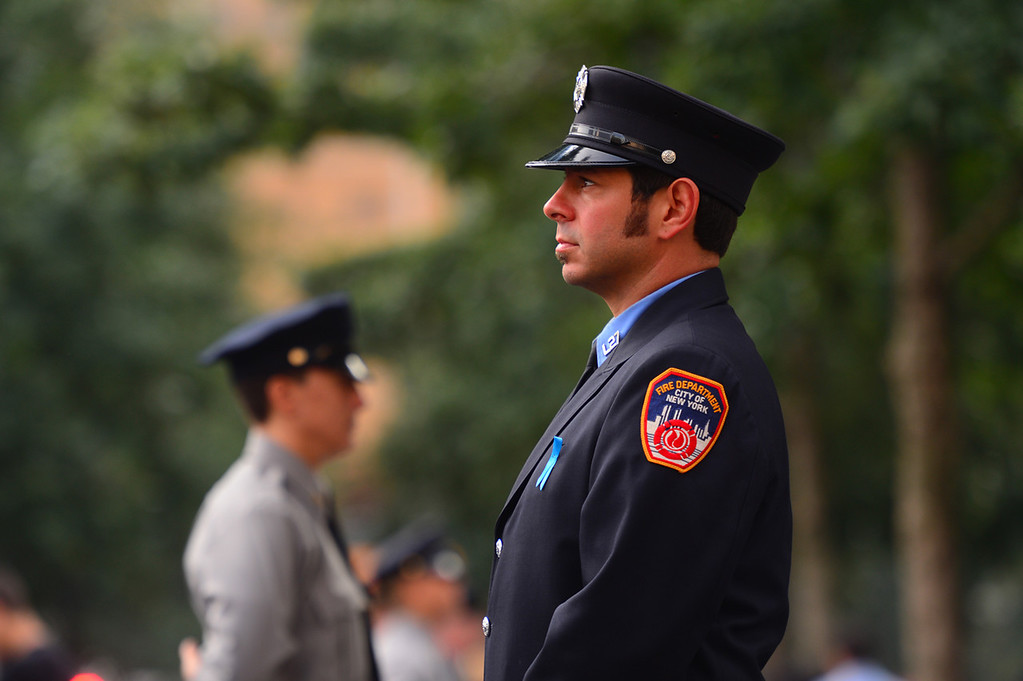 . New York City Firefighter Joe DePaolo pauses to remember his friend Christopher Amoroso at the 9/11 Memorial during ceremonies for the twelfth anniversary of the terrorist attacks on lower Manhattan at the World Trade Center site on September 11, 2013 in New York City.  (Photo by Alejandra Villa-Pool/Getty Images)