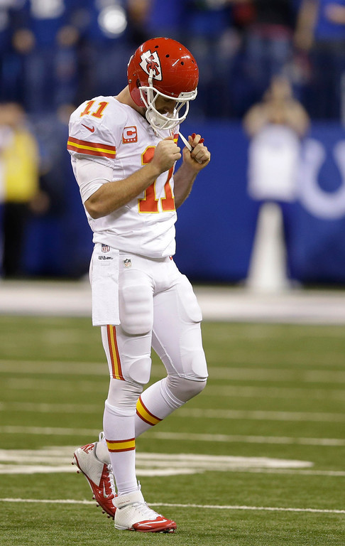 . Kansas City Chiefs\' Alex Smith (11) reacts after getting sacked and fumbling the ball against the Indianapolis Colts during the second half of an NFL wild-card playoff football game Saturday, Jan. 4, 2014, in Indianapolis. (AP Photo/Michael Conroy)