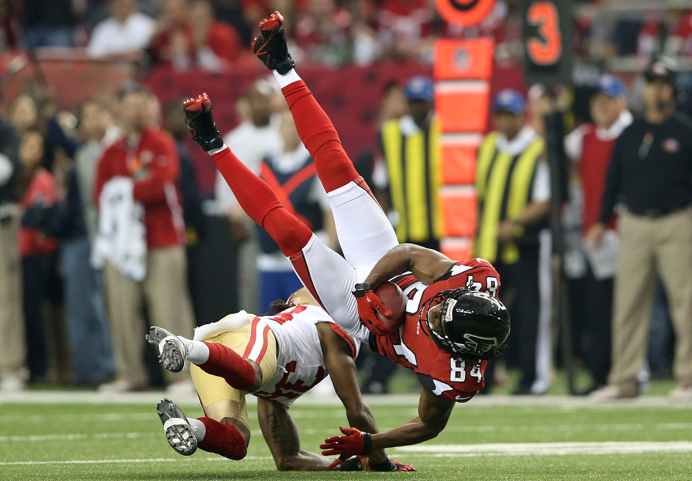 . Wide receiver Roddy White #84 of the Atlanta Falcons catches a pass as he is hit by free safety Dashon Goldson #38 of the San Francisco 49ers in the first quarter in the NFC Championship game at the Georgia Dome on January 20, 2013 in Atlanta, Georgia.  (Photo by Streeter Lecka/Getty Images)