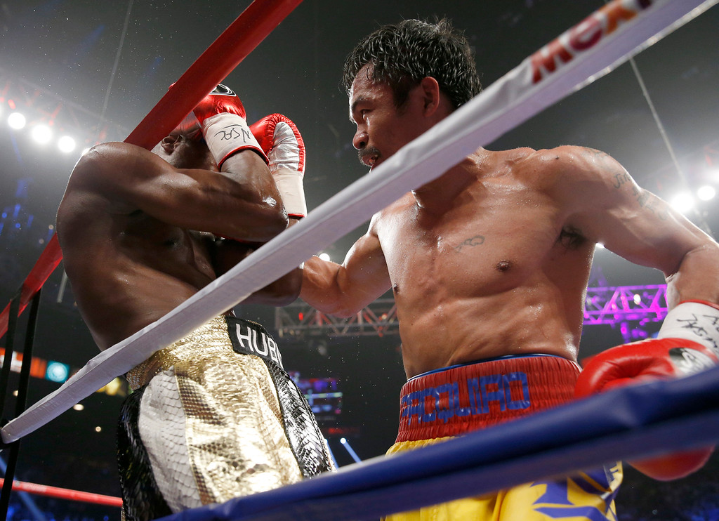 . Manny Pacquiao, from the Philippines, right, punches Floyd Mayweather Jr., during their welterweight title fight on Saturday, May 2, 2015 in Las Vegas. (AP Photo/John Locher)