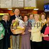 Friends of Daisyhill present their Easter Raffle prize to winner Patricia Mc Guinness from Castleblaney, Ronnie O'Hare (president of friends of daisyhill hospital) hands over the beautiful Easter Egg Basket & Teddy Bear to Patricia, 07W14N88