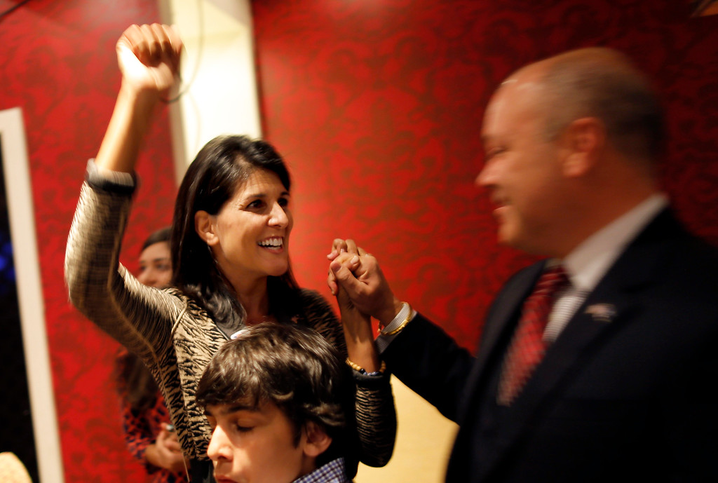 . South Carolina Gov. Nikki Haley, left, celebrates with her husband Michael Haley, right, at campaign headquarters on election day, Tuesday, Nov, 4, 2014, in Columbia, S.C. Haley beat Democratic state Sen. Vincent Sheheen to win a second term. (AP Photo/Stephen B. Morton)