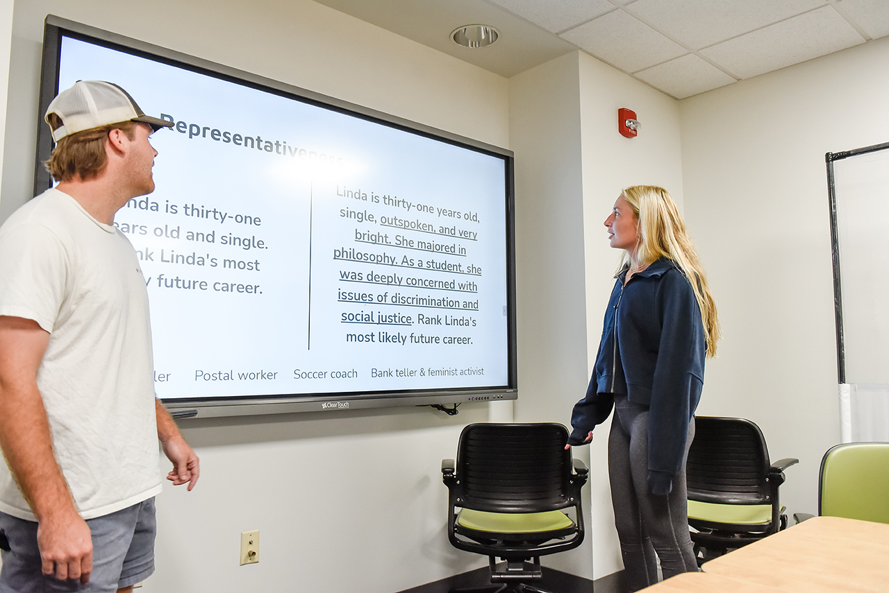 Rawley Smith (left) and Neely Thompson explain concepts to the class.