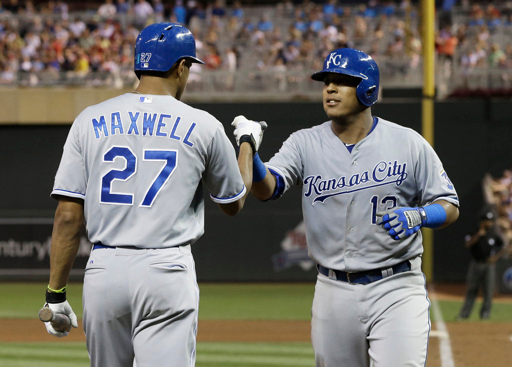 . Kansas City Royals\' Salvador Perez, right, is congratulated by Justin Maxwell after hitting a two-run home run off Minnesota Twins pitcher Andrew Albers in a baseball game. (AP Photo/Jim Mone)