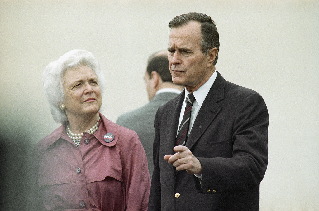 . Vice President George H. W. Bush, right, and wife, Barbara Bush, shown as they go to cast their vote in the Super Tuesday primary, March 8, 1988, Houston, Tex. (AP Photo/Ed Kolenovsky)