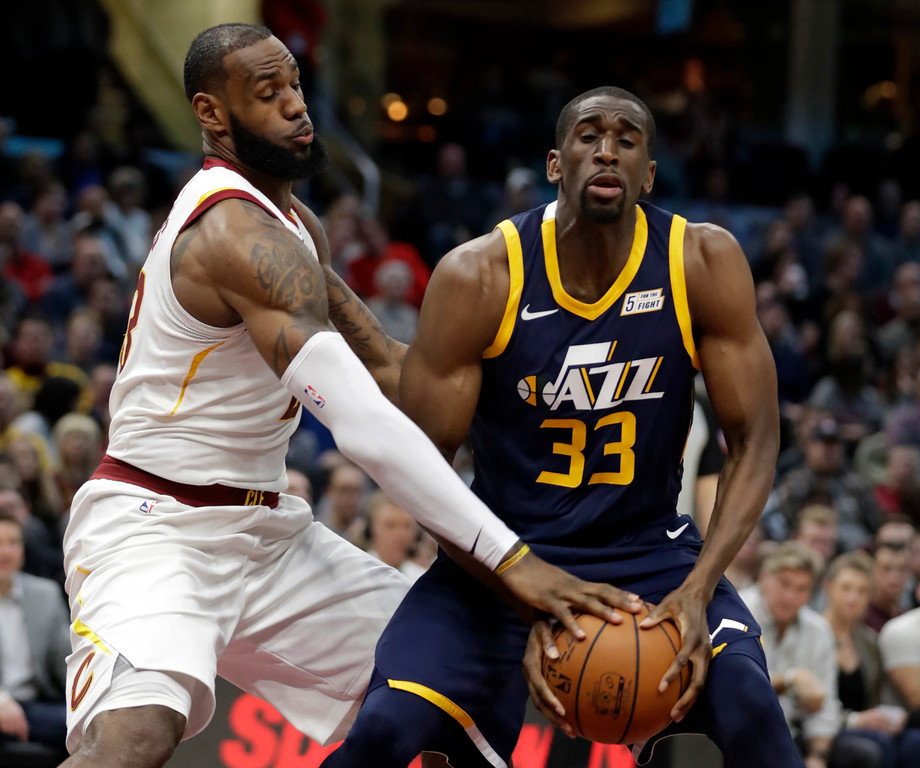 . Utah Jazz\'s Ekpe Udoh (33) tries to get past Cleveland Cavaliers\' LeBron James (23) in the first half of an NBA basketball game, Saturday, Dec. 16, 2017, in Cleveland. (AP Photo/Tony Dejak)