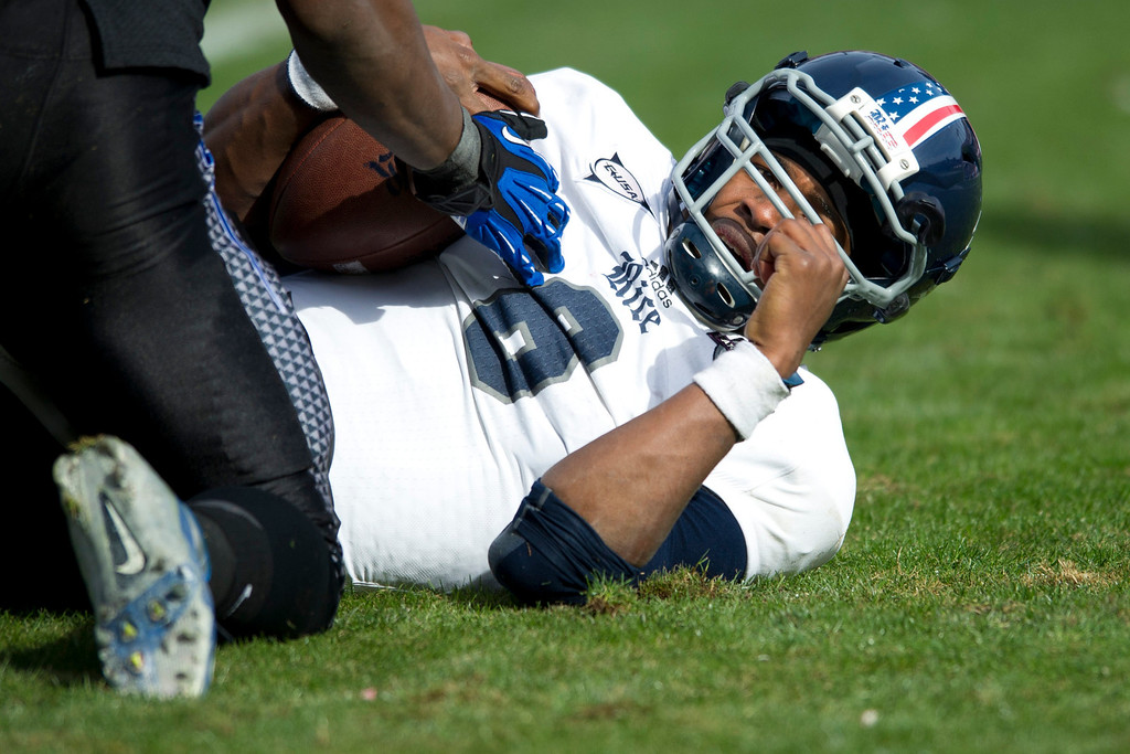 . Driphus Jackson #6 of the Rice Owls lays on the ground after being sacked by the Air Force Falcons on December 29, 2012 during the Bell Helicopter Armed Forces Bowl at Amon G. Carter Stadium in Fort Worth, Texas.  (Photo by Cooper Neill/Getty Images)