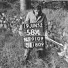 NJ910958A, Man marking Ordnance Survey minor control revision point with an arrow in 1950s