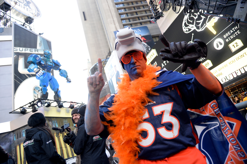 Description of . Denver Broncos fan Lonnie Mareno shows his colors in Times Square. Super Bowl XLVlll fans hit Times Square to enjoy the Super Bowl Boulevard. The NFL transformed a portion of Broadway into the sports and entertainment hub of Super Bowl Week, January 29, 2014. (Photo by John Leyba/The Denver Post)