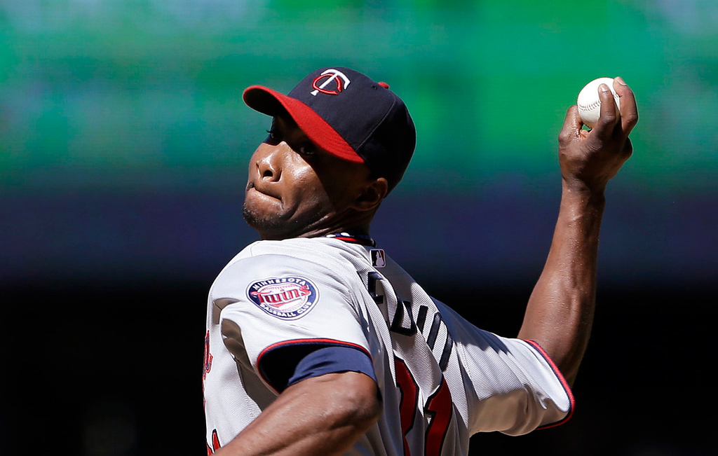 . Minnesota Twins starting pitcher Samuel Deduno throws against the Seattle Mariners in the seventh inning Saturday, July 27, 2013, in Seattle. (AP Photo/Elaine Thompson)