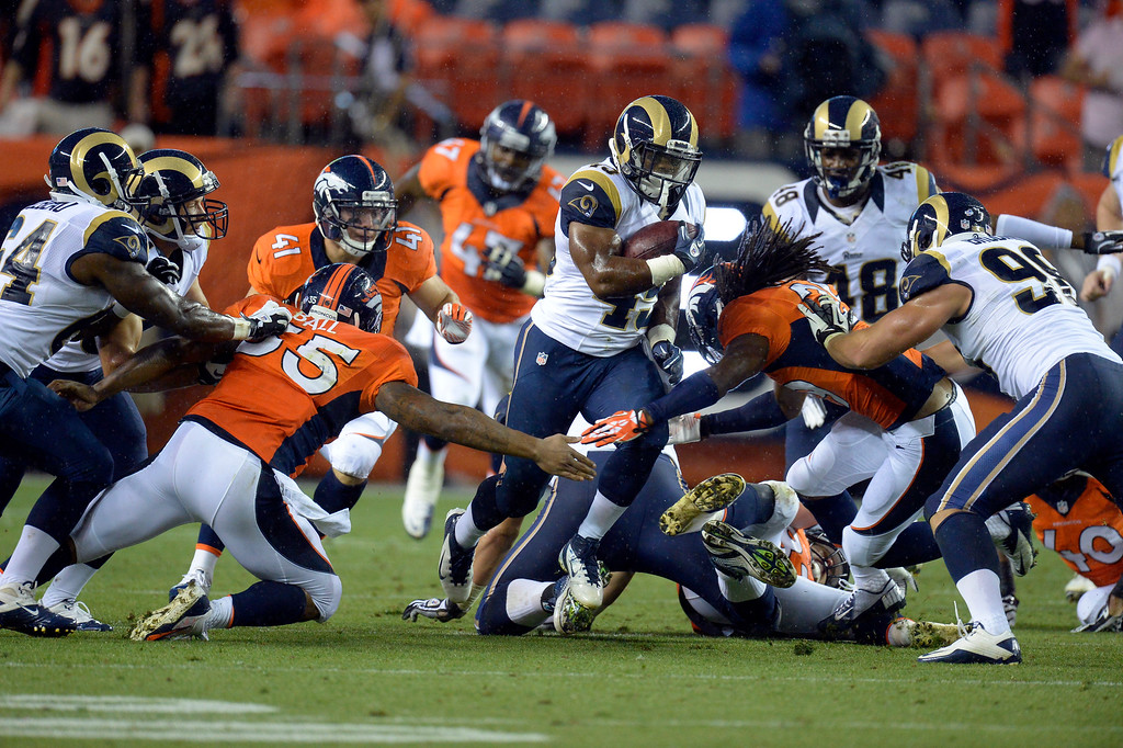 . DENVER, CO. - AUGUST 17: St. Louis Rams running back Benny Cunningham (45) finds a big hole in the Denver Broncos defense during a long run in the fourth quarter August 24, 2013 at Sports Authority Field at Mile High. (Photo By John Leyba/The Denver Post)