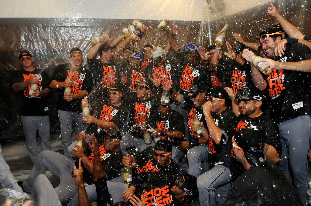 . MINNEAPOLIS, MN - SEPTEMBER 25: The Detroit Tigers celebrate with champagne in the clubhouse after the Tigers defeated the Twins 1-0 on September 25, 2013 at Target Field in Minneapolis, Minnesota. The Tigers clinched the American League Central Division title. (Photo by Hannah Foslien/Getty Images)