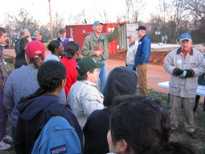 08 03-10 Millard Fuller leading volunteers in devotions before work begins. lf