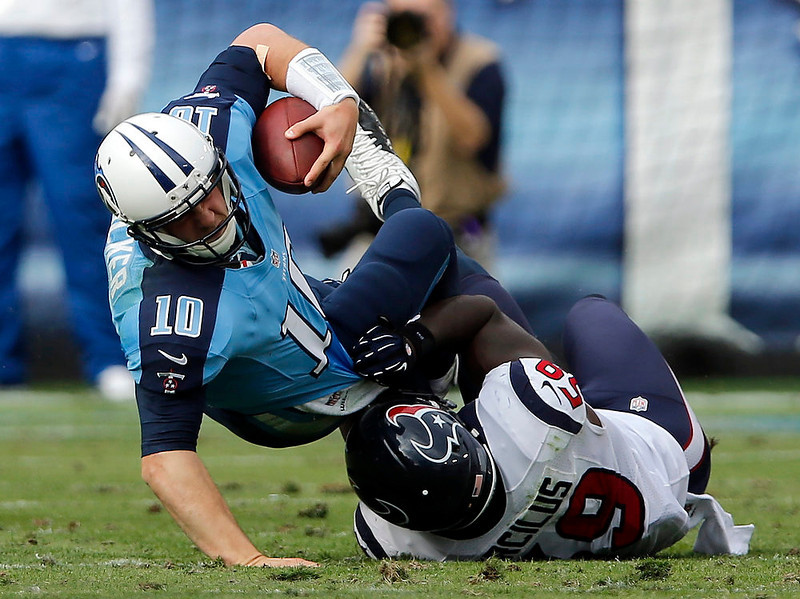 . Tennessee Titans quarterback Jake Locker (10) is sacked for a 1-yard loss by Houston Texans linebacker Whitney Mercilus (59) in the second quarter of an NFL football game on Sunday, Dec. 2, 2012, in Nashville, Tenn. (AP Photo/Joe Howell)