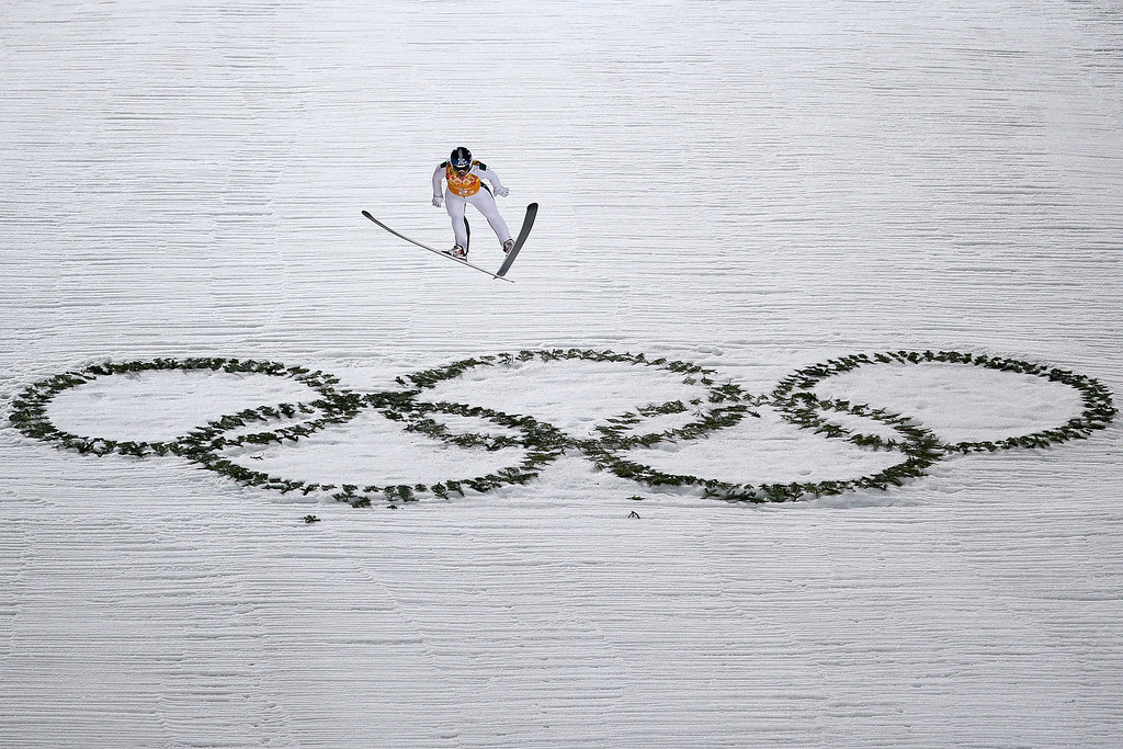 . Anders Johnson of the United States jumps during the Men\'s Team Ski Jumping first round on day 10 of the Sochi 2014 Winter Olympics at the RusSki Gorki Ski Jumping Center on February 17, 2014 in Sochi, Russia.  (Photo by Paul Gilham/Getty Images)