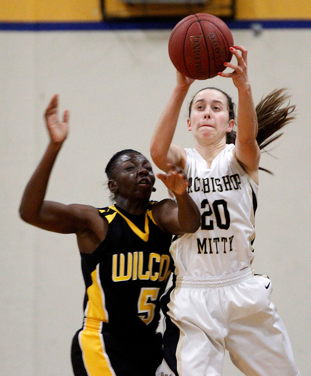 . Archbishop Mitty High School\'s Lauren Mewes (20) grabs a pass against Wilcox High School\'s Jessica King (5) in the first period for the CCS Open Division Girls Basketball semifinals at Oak Grove High School in San Jose, Calif., on Wednesday, Feb. 27, 2013.  (Nhat V. Meyer/Staff)
