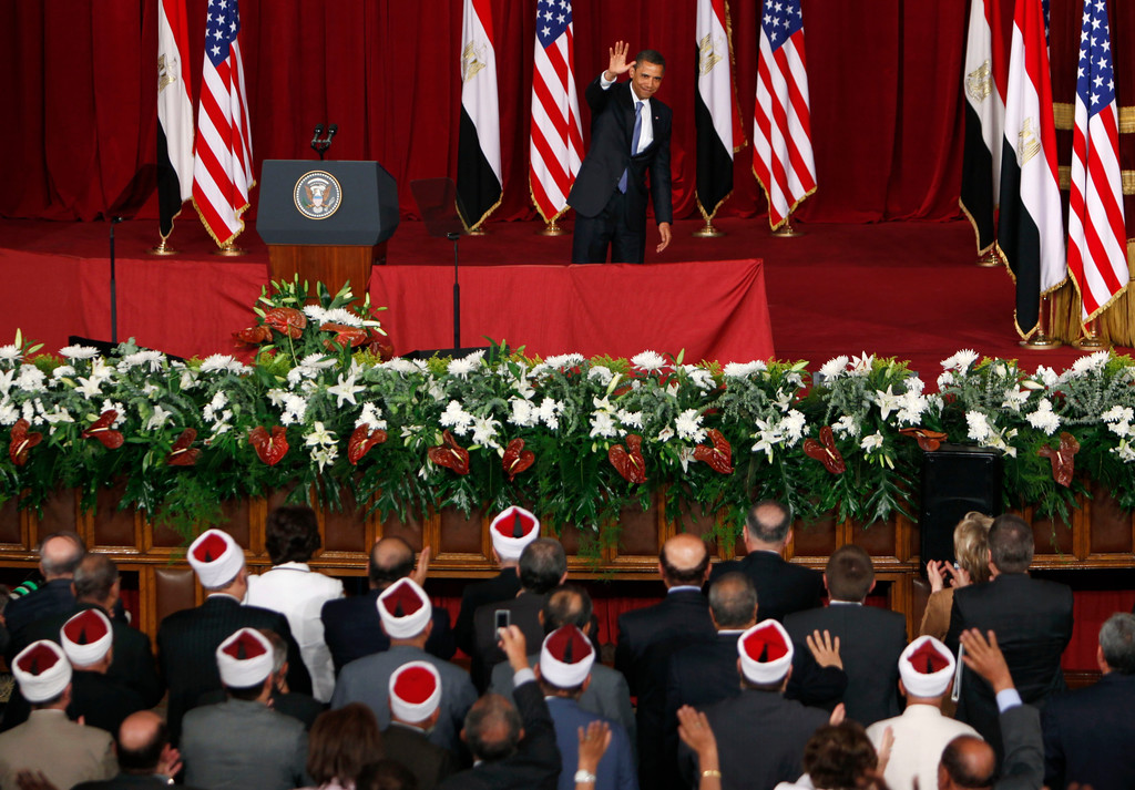 ". U.S. President Barack Obama waves at the audience, after delivering a speech at the Cairo University in Cairo, Egypt Thursday, June 4, 2009. Speaking in the ancient seat of Islamic learning and culture, and quoting from the Quran for emphasis, President Obama called for a ""new beginning between the United States and Muslims\"",  and said together, they could confront violent extremism across the globe and advance the timeless search for peace in the Middle East.  \""This cycle of suspicion and discord must end,\"" Obama said in the widely anticipated speech in one of the world\'s largest Muslim countries, an address designed to reframe relations after the terrorist attacks of Sept. 11, 2001, and the U.S.-led war in Iraq.(AP Photo/Nasser Nasser)"