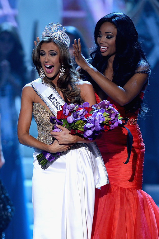 . Miss USA 2012 Nana Meriwether crowns Miss Connecticut USA Erin Brady the new Miss USA during the 2013 Miss USA pageant at PH Live at Planet Hollywood Resort & Casino on June 16, 2013 in Las Vegas, Nevada.  (Photo by Ethan Miller/Getty Images)