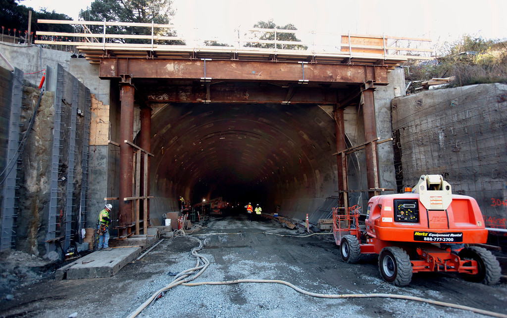 . Heavy machinery enters the East Portal of the Caldecott Tunnel fourth bore project Friday afternoon Jan. 18, 2013 near Orinda, Calif. The long-awaited project expects to open sometime in the latter part of 2013. (Karl Mondon/Staff)