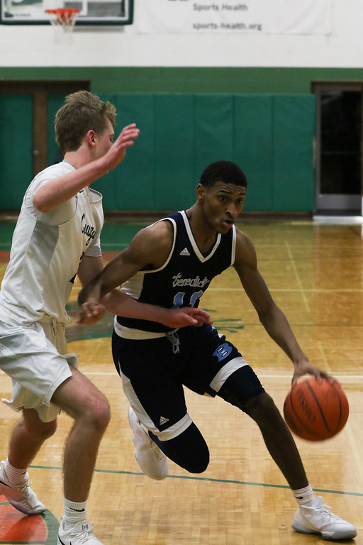 . 2018 - Basketball - Benedictine at Lake Catholic.  Benedictine defeated Lake Catholic 63-56.  Benedictine\'s Mario Caywood (11) tries to drive to the basket against Lake Catholic\'s Sean Fitzgerald (3).