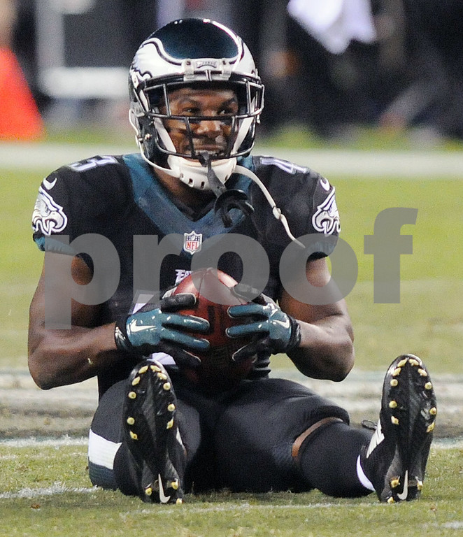 . Eagles RB Darren Sproles (43) sits on the ground with a smile after a long punt return during Sunday nights October 12, 2014 game against the Philadelphia Eagles at Lincoln Financial Field. (Times staff / TOM KELLY IV)