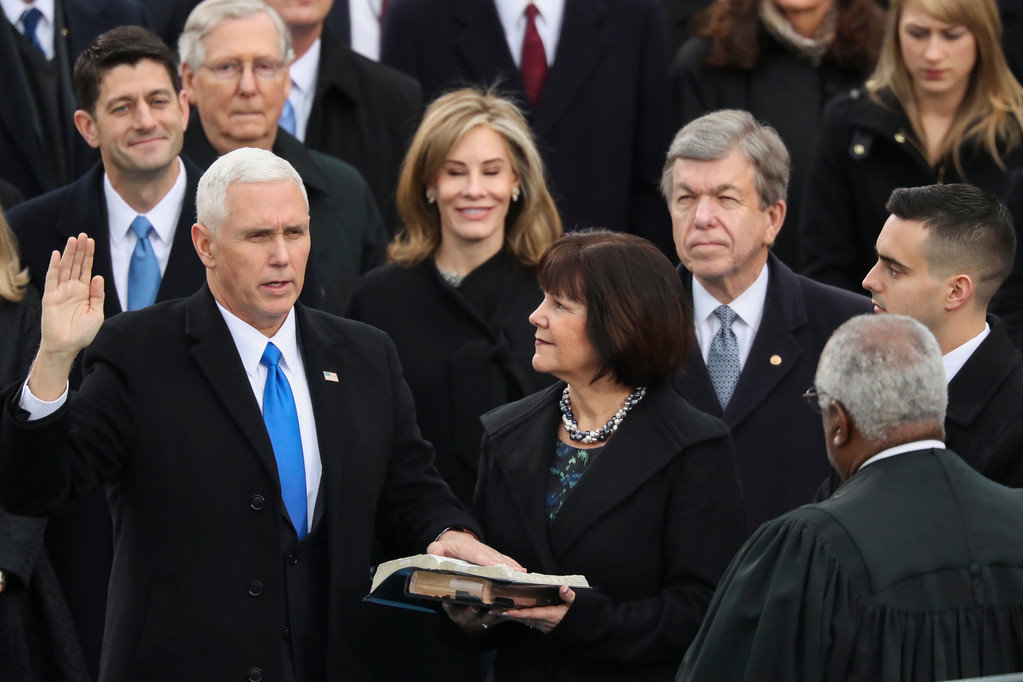 . Vice President Mike Pence is sworn in by Justice Clarence Thomas as this wife Karen holds the bible during the 58th Presidential Inauguration at the U.S. Capitol in Washington, Friday, Jan. 20, 2017. (AP Photo/Andrew Harnik)