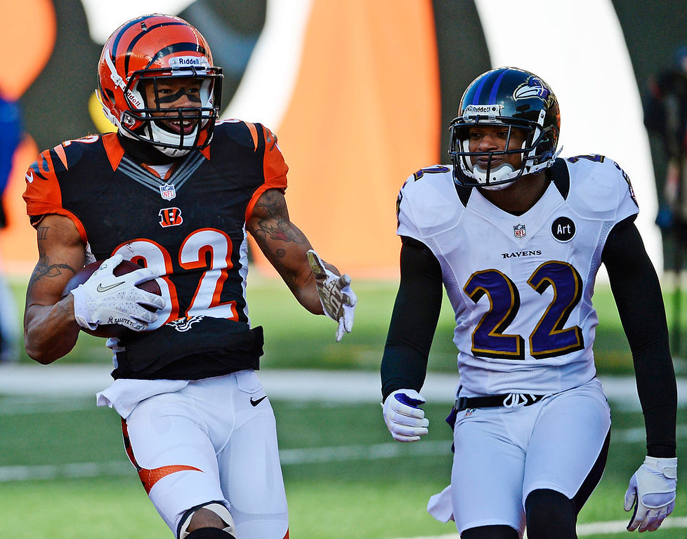 . Cincinnati Bengals wide receiver Marvin Jones (82) scores against Baltimore Ravens cornerback Jimmy Smith (22) on an 11-yard pass reception in the first half of an NFL football game, Sunday, Dec. 30, 2012, in Cincinnati. (AP Photo/Michael Keating)