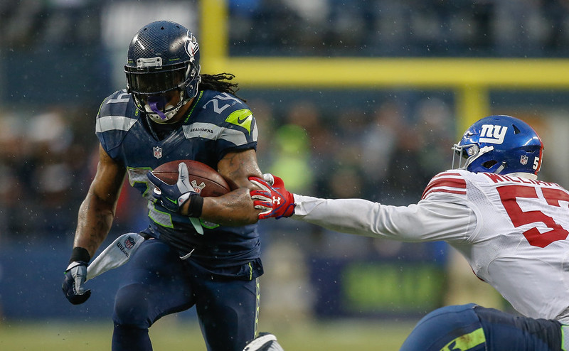 . Running back Marshawn Lynch #24 of the Seattle Seahawks rushes against linebacker Jacquian Williams #57 of the New York Giants at CenturyLink Field on November 9, 2014 in Seattle, Washington. The Seahawks defeated the Giants 38-17.  (Photo by Otto Greule Jr/Getty Images)