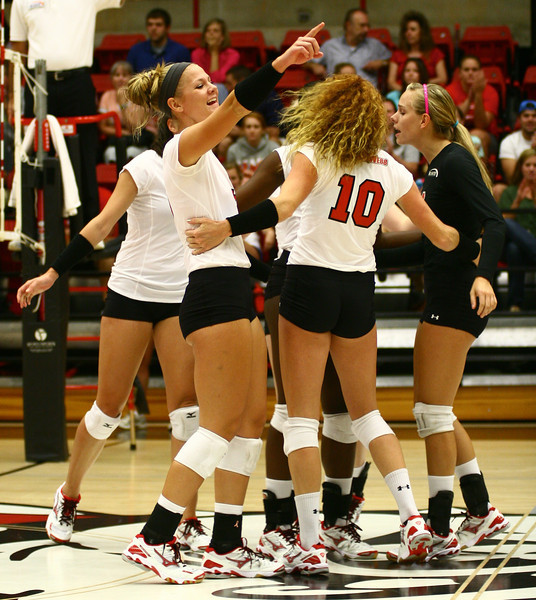 The GWU Volleyball team rejoices over a scoring point.