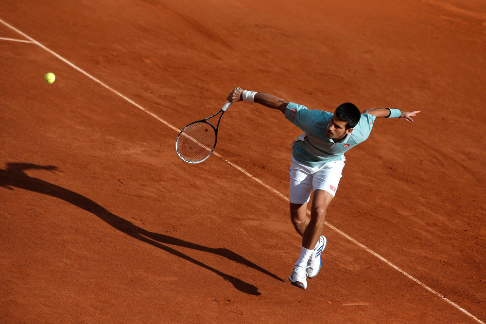 . Serbia\'s Novak Djokovic returns against David Goffin of Belgium during their first round match at the French Open tennis tournament, at Roland Garros stadium in Paris, Tuesday, May 28, 2013. (AP Photo/Michel Spingler)