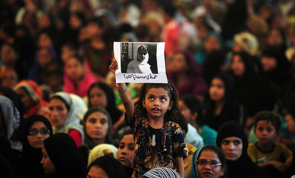 . A Pakistani female supporter of the Muttahida Quami Movement (MQM) carries a photograph of gunshot victim, Malala Yousafzai as she prays for the recovery of Malala Yousafzai, in Karachi on October 10, 2012. Pakistani doctors removed a bullet from a 14-year-old child campaigner shot by the Taliban in a horrific attack condemned by national leaders and rights activists. The attack took place in Mingora, the main town of the Swat valley in Pakistan\'s northwest, where Malala had campaigned for the right to an education during a two-year Taliban insurgency which the army said it had crushed in 2009.   RIZWAN TABASSUM/AFP/GettyImages