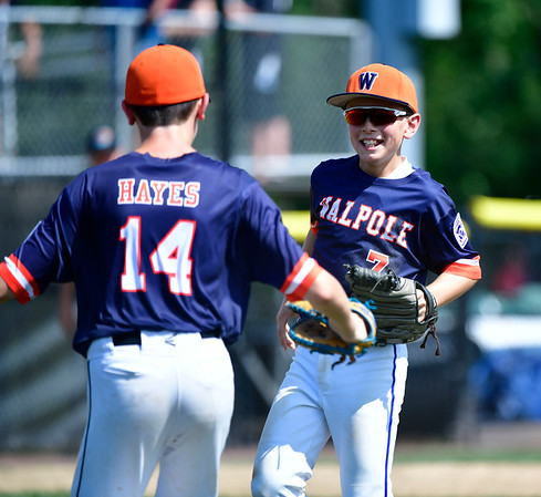 8/4/2019 Mike Orazzi | Staff Massachusetts's Richie Hayes (14) Beckett Delleo (7) celebrate a win over Maine during their opening round game of the New England Regional Little League Baseball Tournament in Bristol on Sunday.