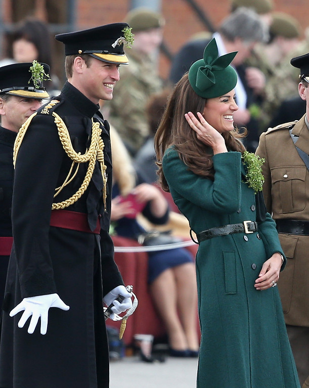 . Catherine, Duchess of Cambridge and Prince William, Duke of Cambridge laugh as they present \'Shamrocks\' during the St Patrick\'s Day parade at Mons Barracks on March 17, 2014 in Aldershot, England. Catherine, Duchess of Cambridge and Prince William, Duke of Cambridge visited the 1st Battalion Irish Guards to present the traditional sprigs of Shamrocks to the Officers and Guardsmen of the Regiment.  (Photo by Chris Jackson/Getty Images)