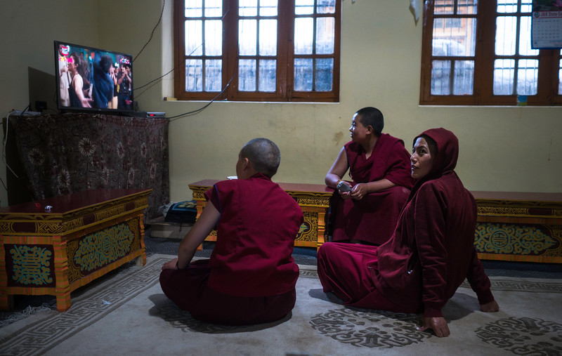 Young nuns  watches Indian TV  soaps on Sunday in Thubstan Choskorling nunnery, Skara Village. The students are encouraged for the holistic upbringing so that they remain aware of the outer world as well.