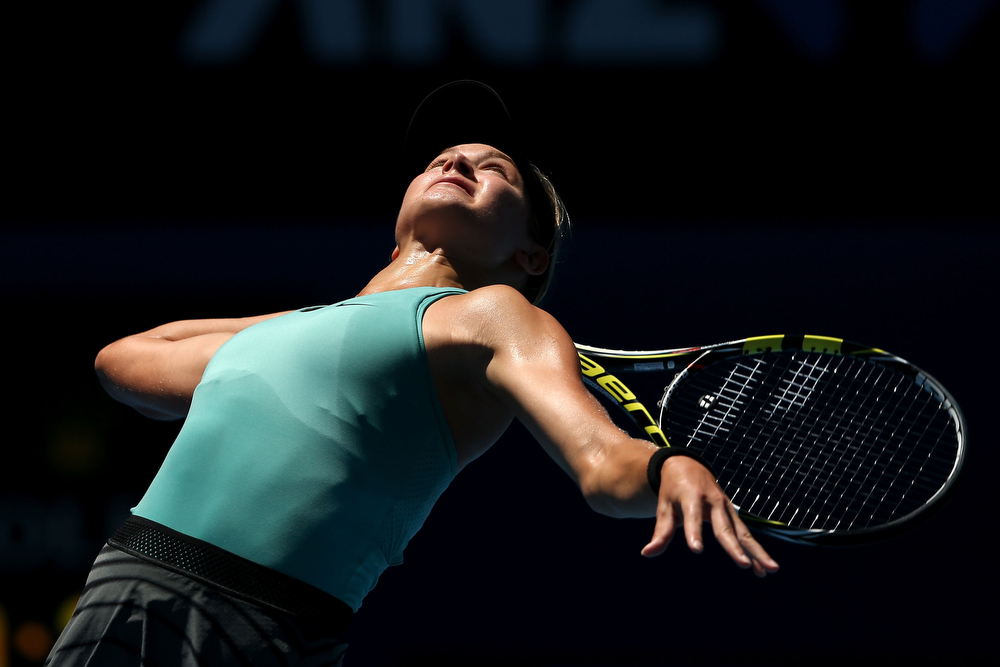 . Eugenie Bouchard of Canada serves in her semifinal match against Na Li of China during day 11 of the 2014 Australian Open at Melbourne Park on January 23, 2014 in Melbourne, Australia.  (Photo by Clive Brunskill/Getty Images)
