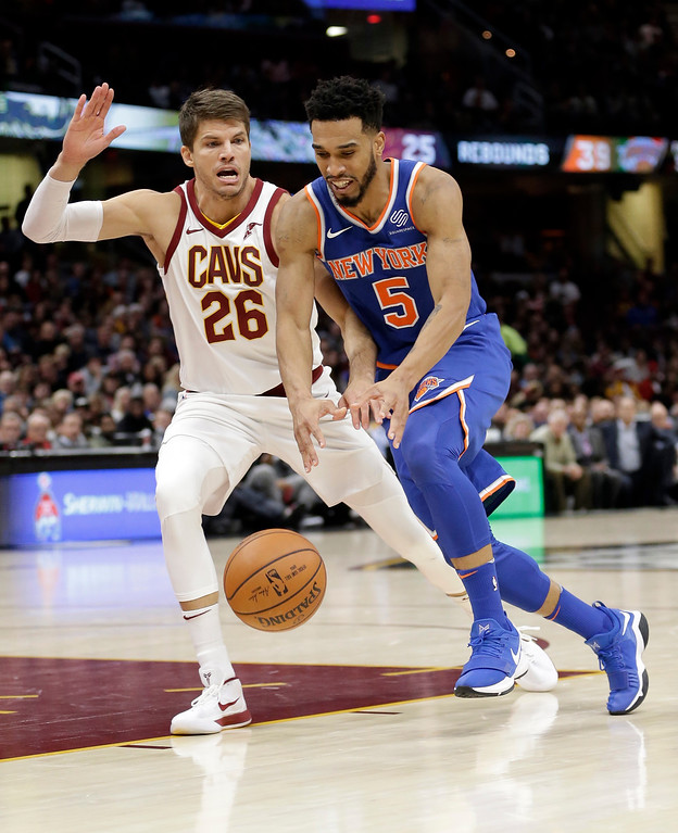 . New York Knicks\' Courtney Lee (5) drives against Cleveland Cavaliers\' Kyle Korver (26) in the second half of an NBA basketball game, Sunday, Oct. 29, 2017, in Cleveland. (AP Photo/Tony Dejak)