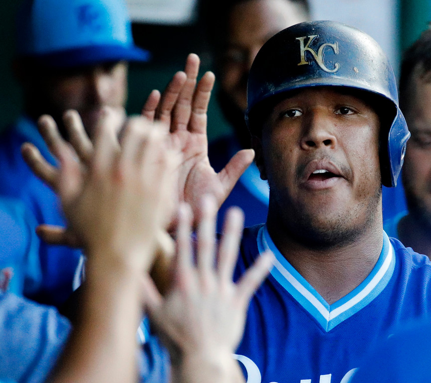 . Kansas City Royals\' Salvador Perez celebrates in the dugout after scoring on a double by Ryan O\'Hearn during the fourth inning of a baseball game against the Cleveland Indians on Saturday, Aug. 25, 2018, in Kansas City, Mo. (AP Photo/Charlie Riedel)