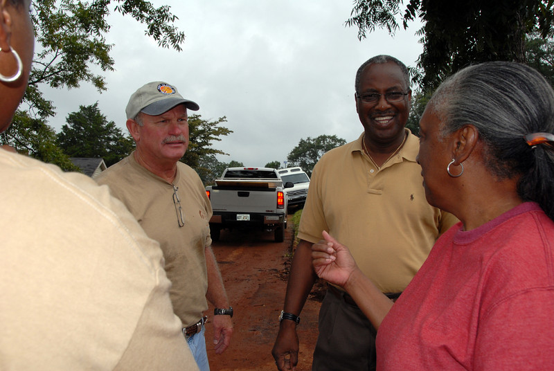 Darren Kelley and Mayor Crawley stopping briefly to visit with a local resident. cl