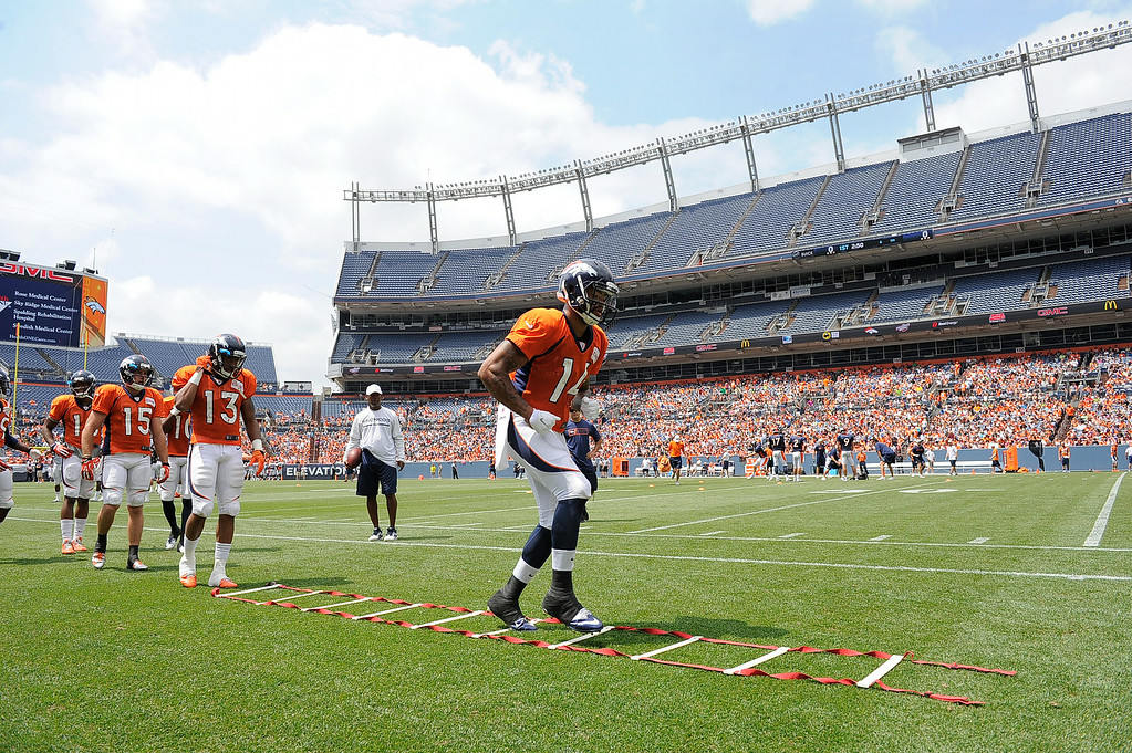 . Denver Broncos wide receiver Cody Latimer (14) runs through drills on day four of the Denver Broncos 2014 training camp July 27, 2014 at Sports Authority Field at Mile High. (Photo by John Leyba/The Denver Post)