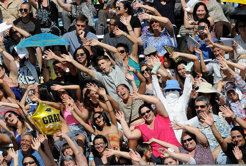 """. Parents follow along with Principal Frank Ferry as they do the \""""Worlds Largest Roller Coaster.\"""" The Commencement Exercises for the Bishop Alemany High School Class of 2013 was held at College of the Canyons in Santa Clarita, CA 6/1/2013(John McCoy/LA Daily News)"""